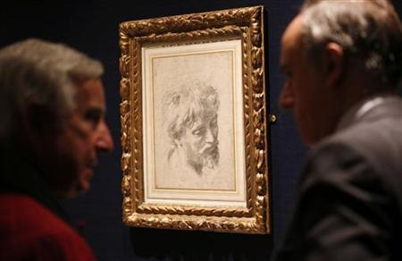 """Visitors look at Raphael's """"Auxiliary cartoon for the Head of a Young Apostle from 1519-1520 at Sotheby's London"""