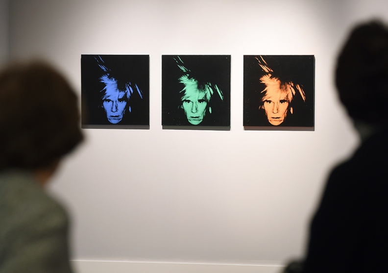 Andy Warhol self-portraits during a preview of Sotheby's contemporary art evening sale in New York, May 2, 2014. (Emmanuel Dunand/AFP/Getty Images)