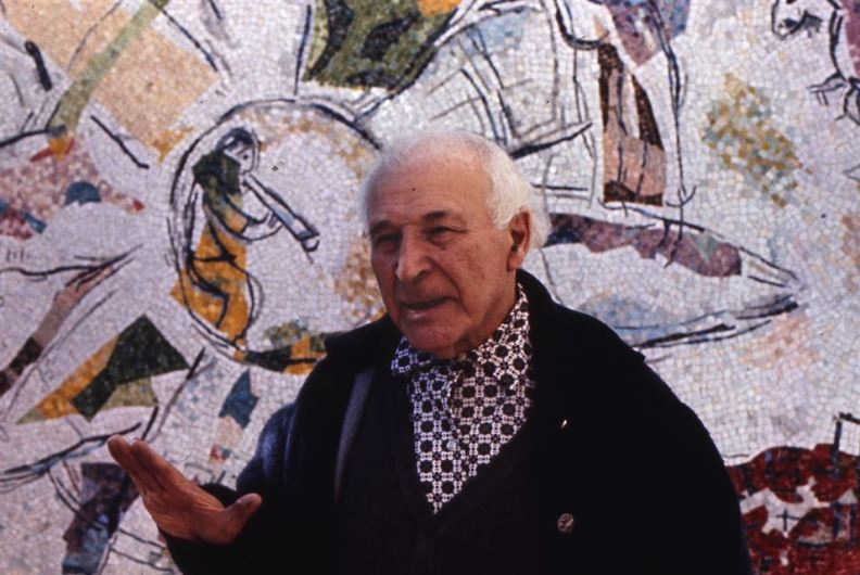 In this image: Russian-born French painter Marc Chagall, 82, is portrayed in front of a mosaic he designed in his villa in Saint-Paul de Vence, southern France, November 25, 1969. AP Photo.
