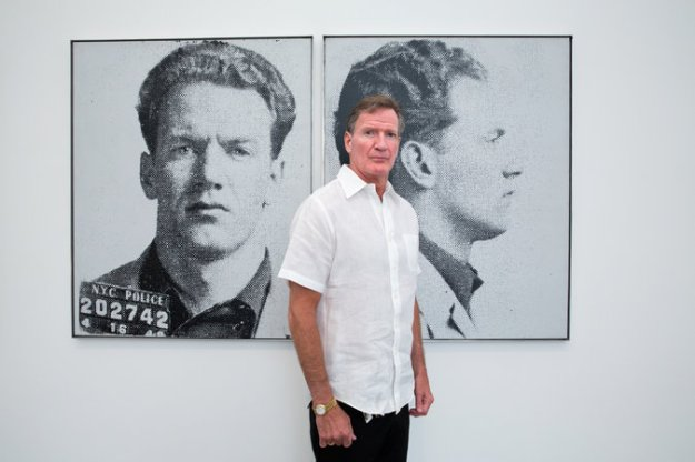 George Lawler next to a Warhol portrait of his father, Thomas Francis (Duke) Connelly, which he by chance found out existed. Credit Sara Krulwich/The New York Times; the work of Andy Warhol licensed by The Andy Warhol Foundation for the Visual Arts, Inc./Artists Rights Society (ARS), New York