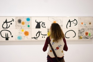 "A visitor looks at works titled ''Lapidarium - Book of the Property of Stones'' by Spanish artist Joan Miro during a preview of the exhibition ""From Earth to Sky"" at the Albertina museum in Vienna. From September 12, 2014 to January 11, 2015, the museum is showing a solo exhibition on the Catalan artist and master of surrealism. AFP PHOTO / JOE KLAMAR."