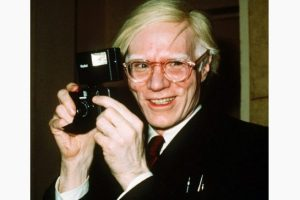 Pop artist Andy Warhol smiles in New York in this 1976 file photo. Warhol's 87th birthday would have been Today, Aug. 6, 2015. Warhol died in 1987. (AP Photo/Richard Drew, File)